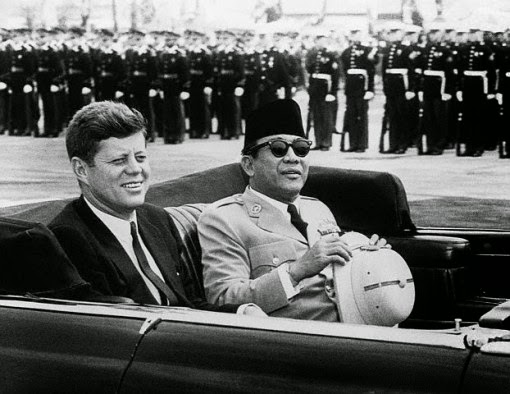 President Sukarno and US President Kennedy, sitting together in an open car