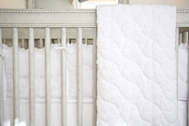 Crib, white quilt and bumper; Baby nursery; Nursery in the Nest; Nora's Nest