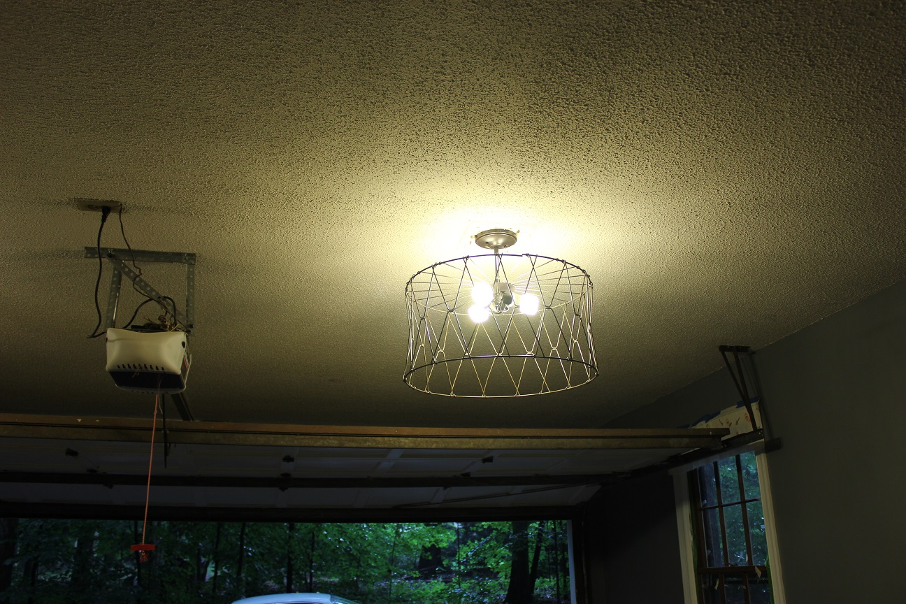 The Handcrafted Life Garage Makeover Progress New Lighting Wiring A Light Fixture To Old Wire Baskets Upside Down Over Rod And Them Up Where Our Fixtures Used Be Put In Some Bulbs Of Course