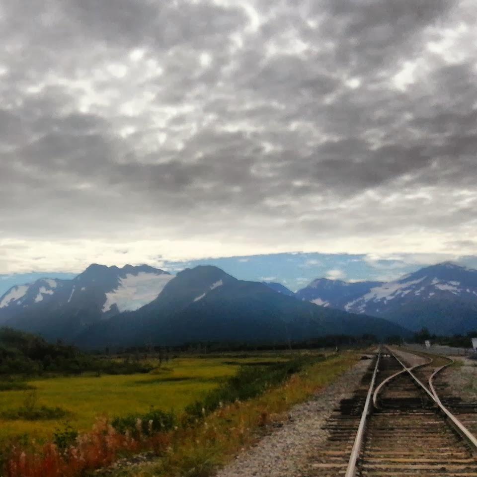 Mountain range near some railroad tracks