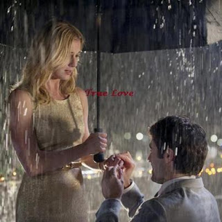 loving couple in rain with umbrella