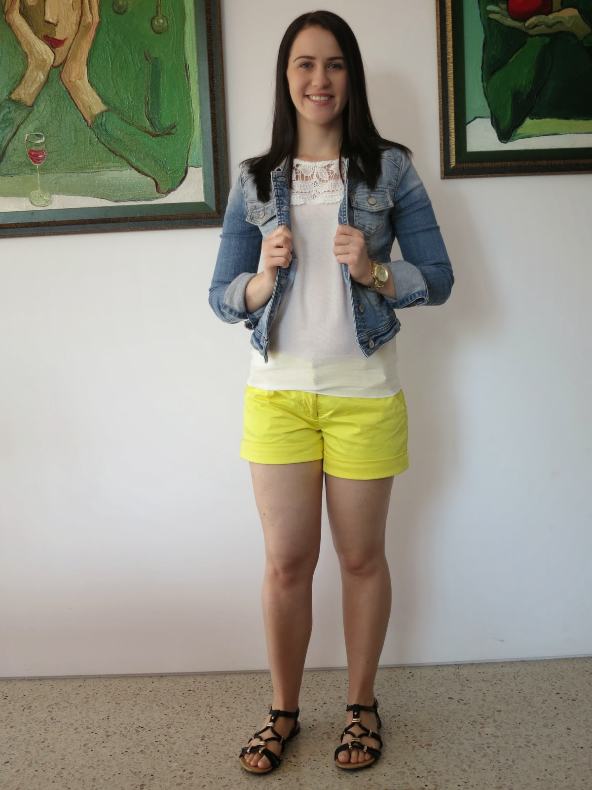 petite girl outfit, petite outfit, everyday outfit, summer outfit, bright yellow shorts, denim jacket, black and gold sandals and bag
