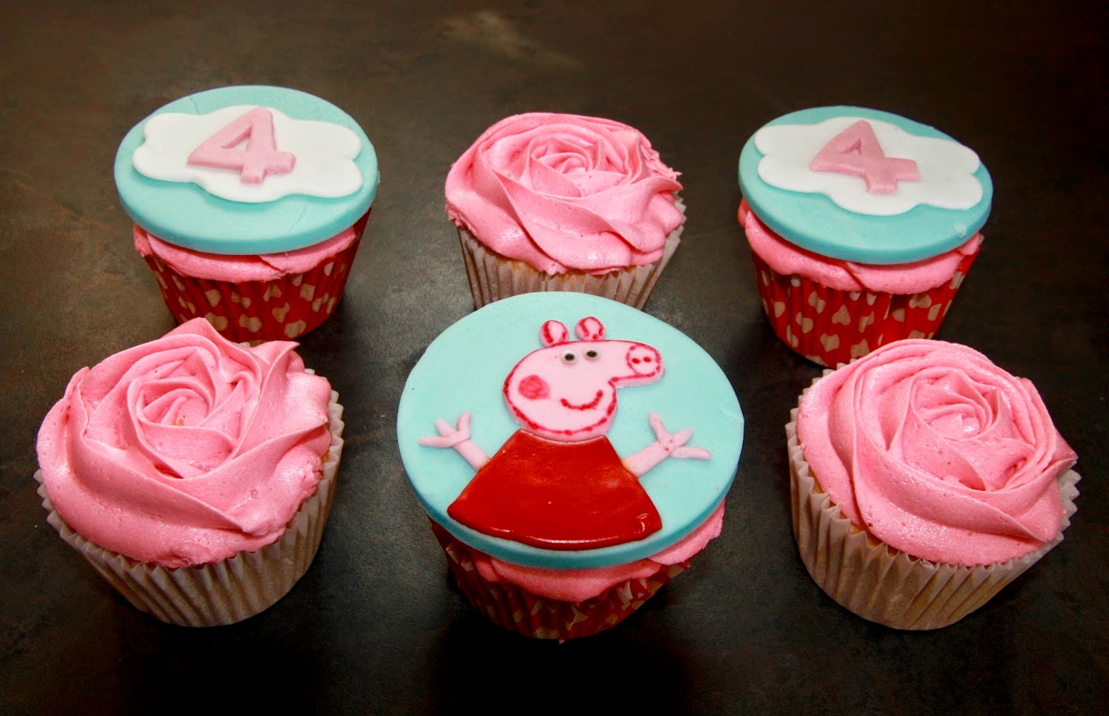 6 Peppa Pig cupcakes - 3 with Peppa Pig cupcake toppers and 3 with rose swirl of buttercream