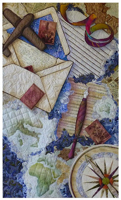 Art quilt with envelope, letter, pen, maps