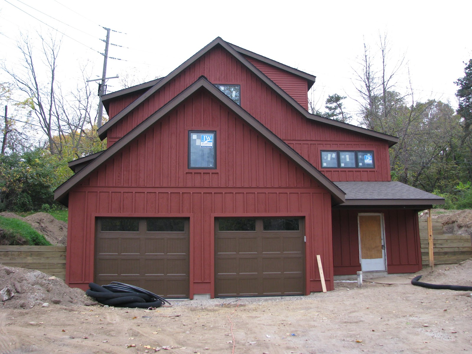 Discussed garage doors we went with plain brown to match the trim