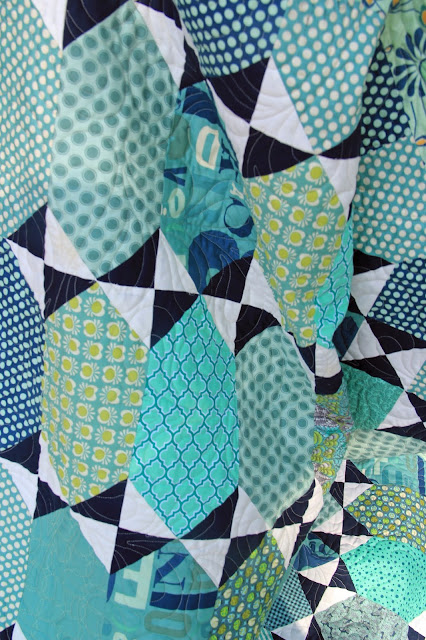 Tula Pink's Pancakes pattern in blues and seafoam.- quilting closeup