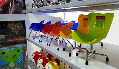 1/6 scale Daiso plastic chairs on display.