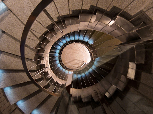 Picture of round concrete staircase as seen from the top floor looking down