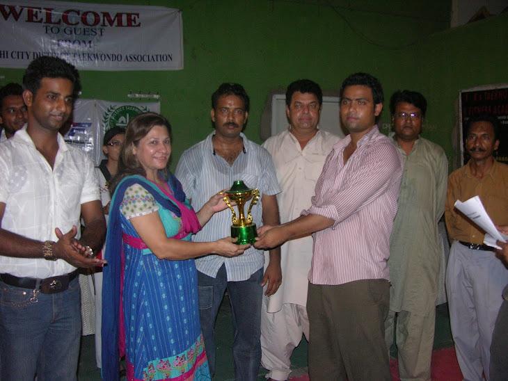 KCDTZ Zone 1 coach rcving 3rd position trophy