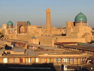 Bukhara's skyline, showing the minarets and tiled domes of this famous Central Asian city.