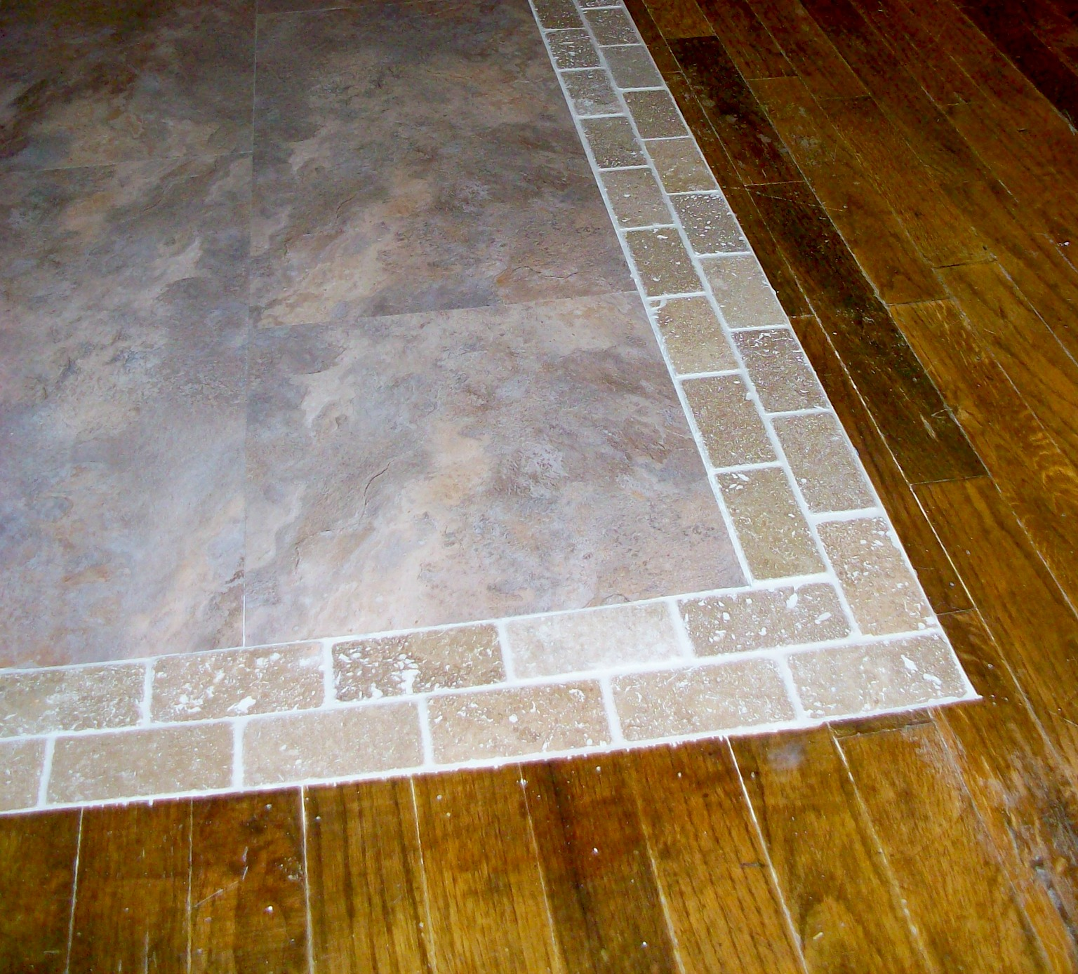 Homesteading wife wood floor to tile transition for Tile and hardwood floor