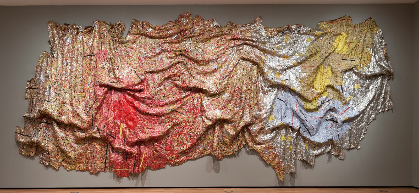 Color, Scale, Texture, And Sweeping Movement What Looks Like Luxurious  Folds Of Cloth Is Actually Sculpture Made From Bottle Caps—sculpture That  Can Be