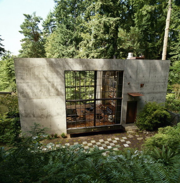 Olson Kundig Architects cement house in woods