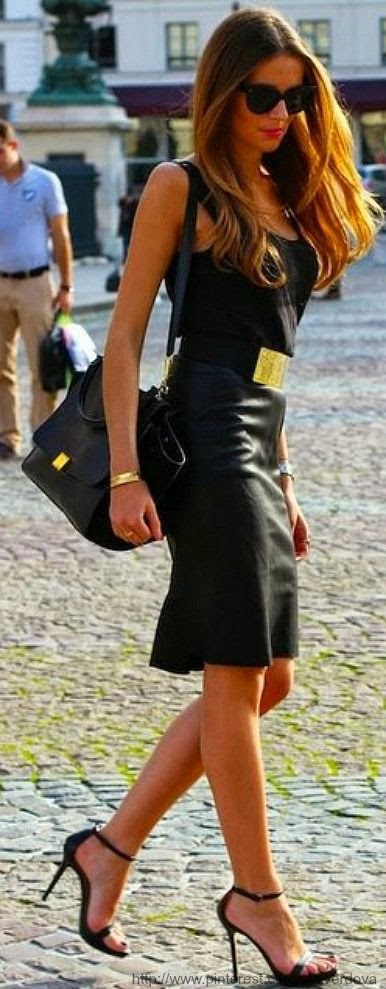 Black shiny dress with handbag and sunglasses