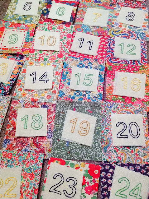 Hand-stitched numbers ready for stitching on Liberty pockets
