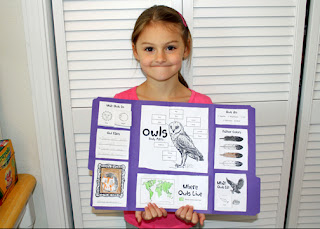 Tessa's nearly completed Blue House School Owls: A Little Learners Lapbook. (She wanted to color the cover art after lunch, so we waited until then to glue it on.) This was her first lapbook. It's not perfect, but I think she did a pretty nice job. She's very proud of it. I especially love her drawing of a common screech owl.