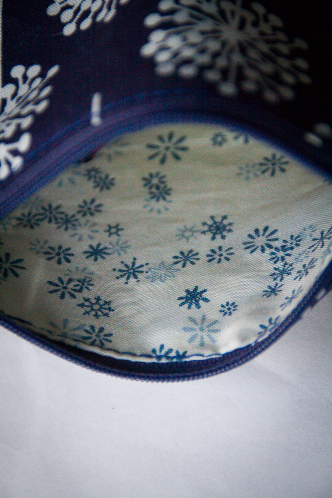 little pouch of dark blue dandelion fabric and white tassel