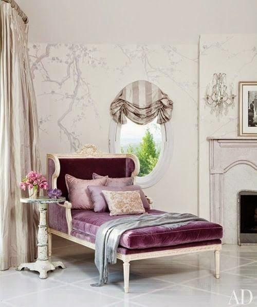 purple velvet chaise white tile floor gray tree branch mural living room design