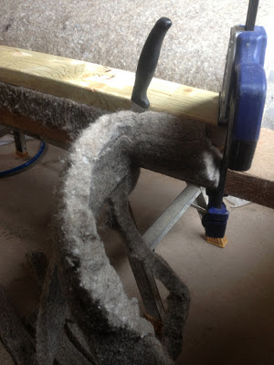High-tech solution for cutting sheepswool insulation to size - two cramps, some wood and a breadknife