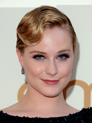 A glammed-up Evan Rachel Wood dazzles with a slicked-back hairstyle, perfectly combed finger waves and sky-high lashes.