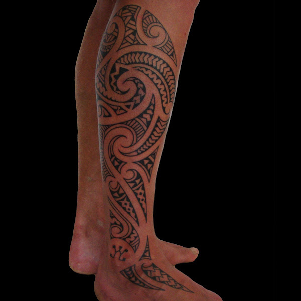 maori influenced leg tattoo