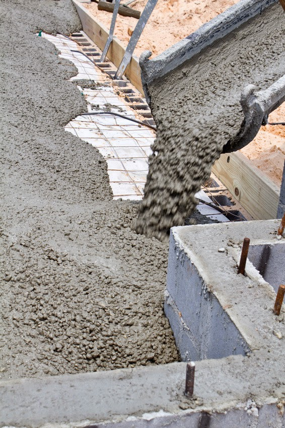Concrete is the world's most-used construction material, and a leading contributor to global warming, producing as much as one-tenth of industry-generated greenhouse-gas emissions. (Credit: © sframe / Fotolia)  Click to enlarge.
