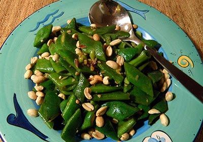 Garlic Ginger Bean Pods on Plate Sprinkled with Peanuts