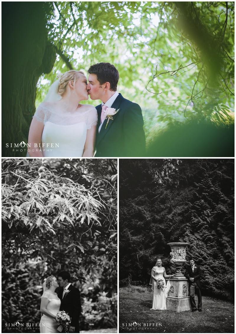 Huntsham Court wedding photography in gardens with bride and groom