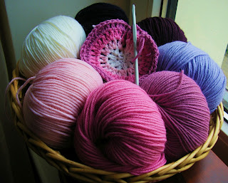 Basket of wool in graduating shades of pink and purple