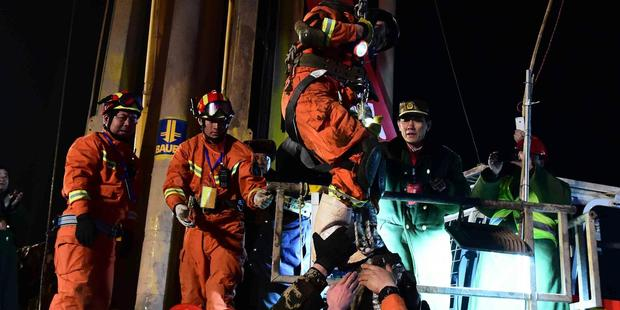 Trapped miners rescued after 36 days underground