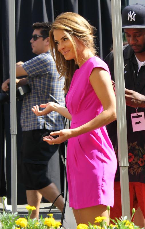 Maria Menounos wearing a pink dress