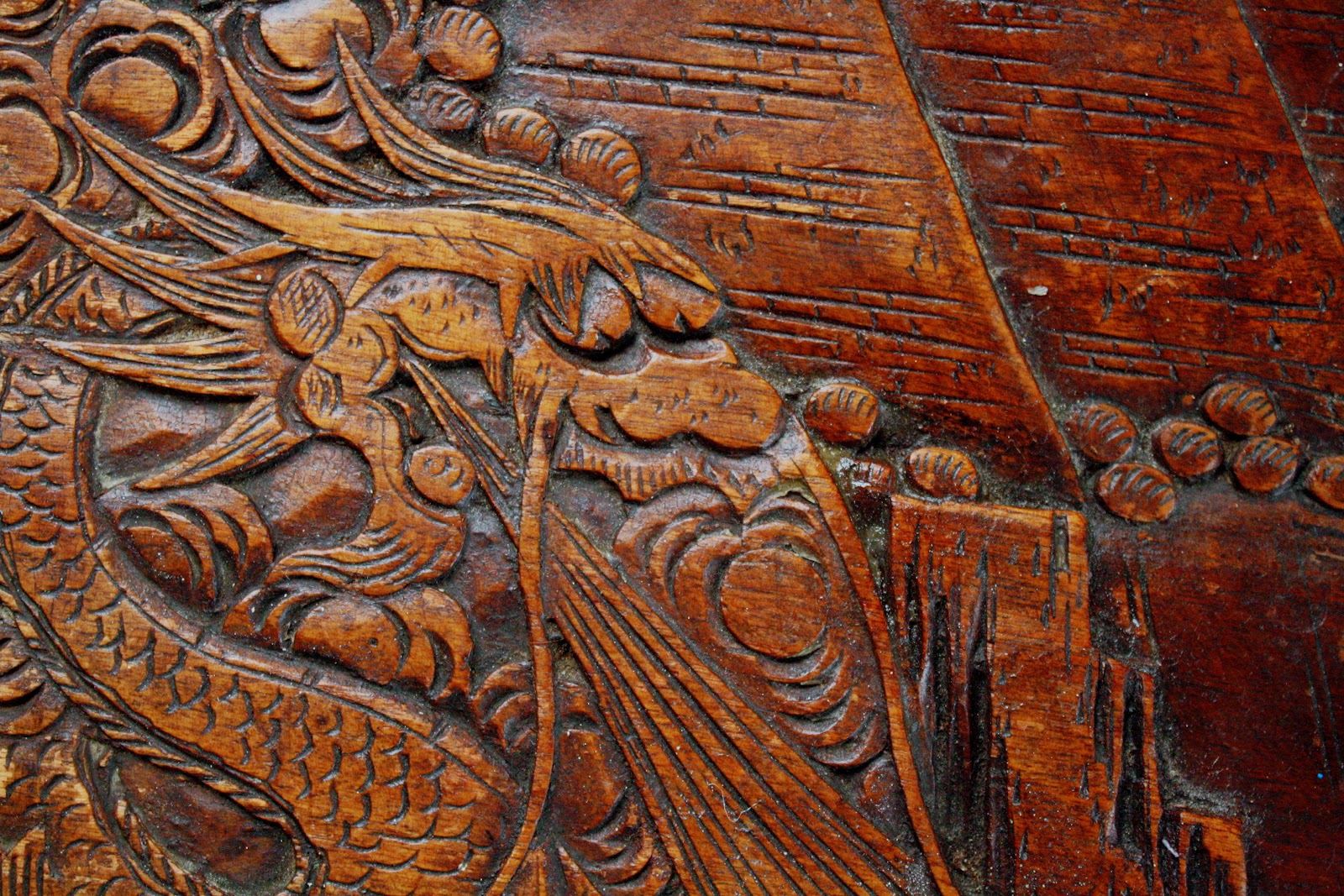 A dragon carved into the lid of a camphor wood chest.