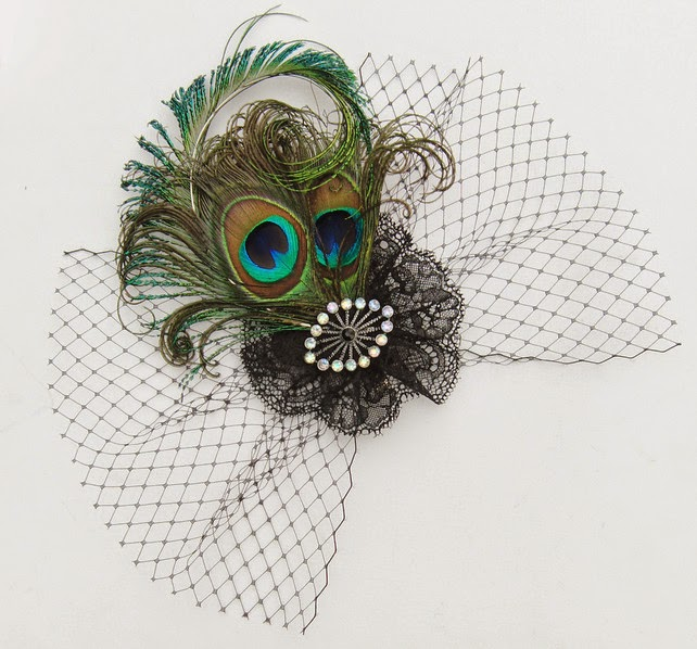 http://folksy.com/items/4410964-Peacock-feather-veil-fascinator-