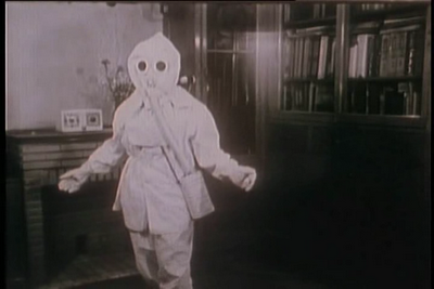 A boy wearing a gas mask during the Cold War in The Atomic Cafe