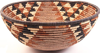 Isiquabetho African Zulu baskets are large bowl shaped baskets used for gathering and carrying harvested foods and every day materials.