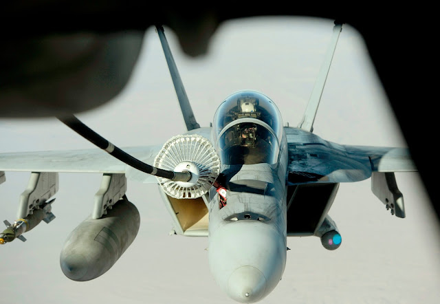 U.S Navy F/A-18 Hornet refueling from a KC-135.