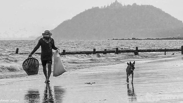 Fisherman and his dog