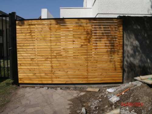 Rejas cobertizos portones electricos for Cobertizos metalicos