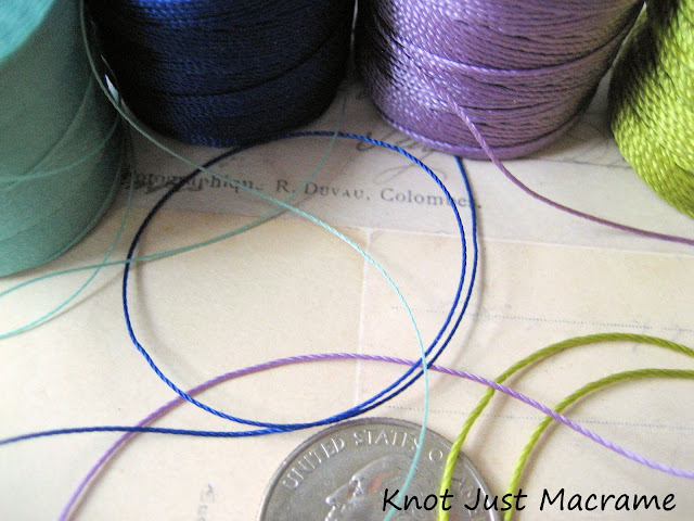 Close up of different sizes or weights of bead cord for micro macrame