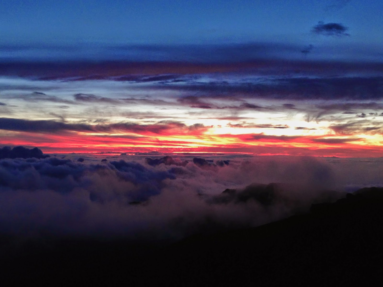sun rising over Haleakala Crater in Maui