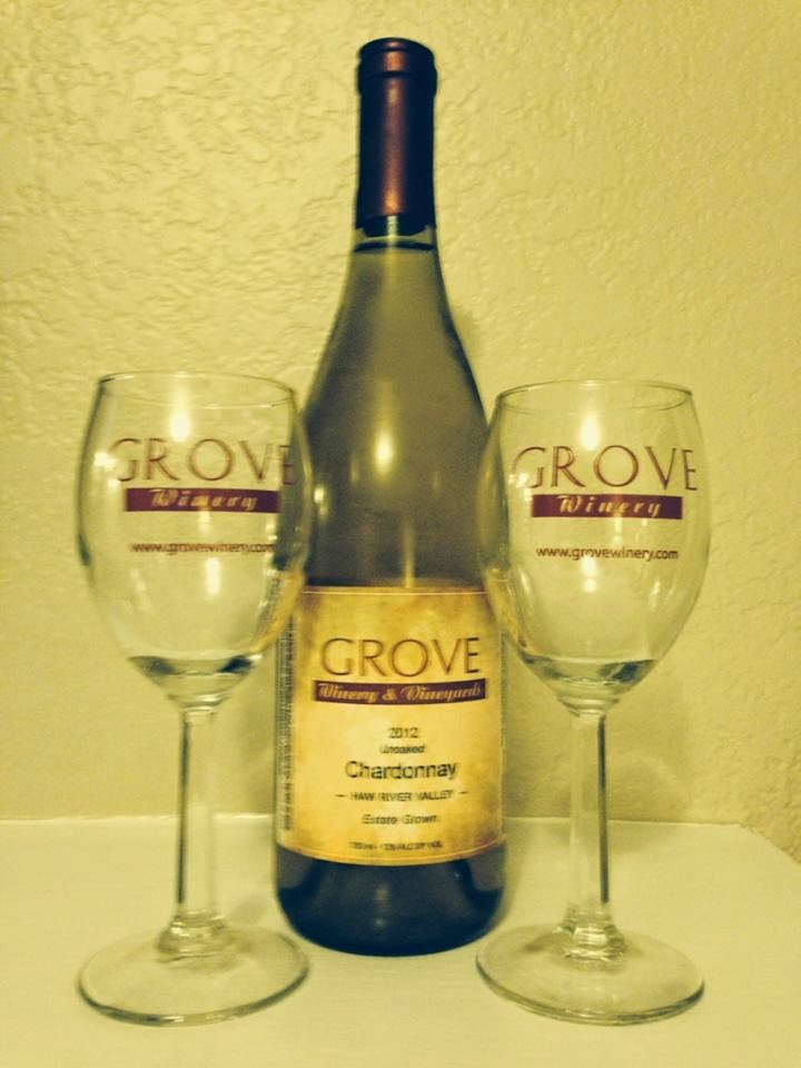 bottle of Grove Winery unoaked Chardonnay with tasting glasses