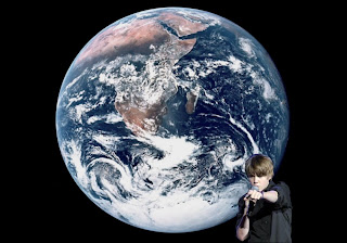 Justin Bieber in Concert free posters wallpapers in Earth from Space background