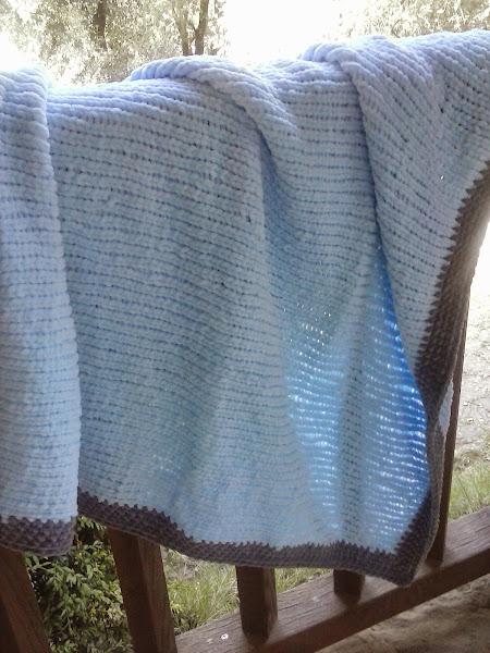 Manta a dos agujas aprender manualidades es for Colchas de punto de lana