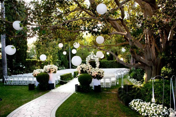 Sweet and simple, accented with paper lanterns hanging fromtrees