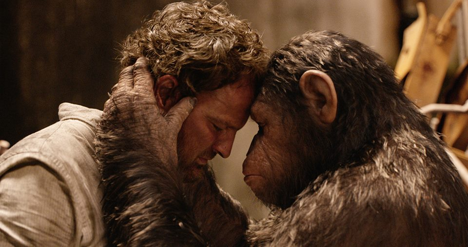 Dawn of the Planet of the Apes Malcolm (Jason Clarke) & Caesar (Andy Serkis)