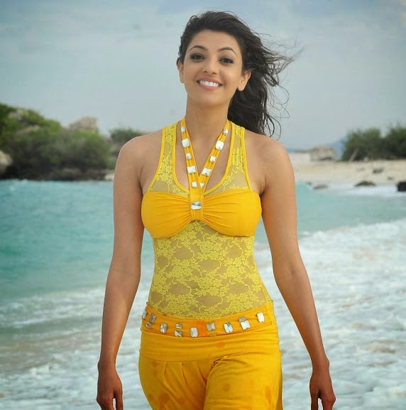 Hot Kajal Aggarwal Smiling Near Sea Side In Yellow Dress