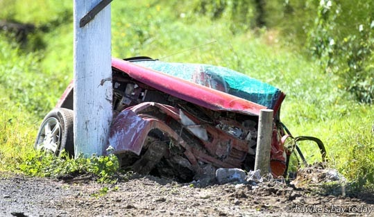 A one-vehicle accident where a car veered off Pakowhai Rd, Pakowhai, crashed into a stormwater drain, hit a power pole and broke some powerlines, just north of the Chesterhope Bridge at Pakowhai. photograph