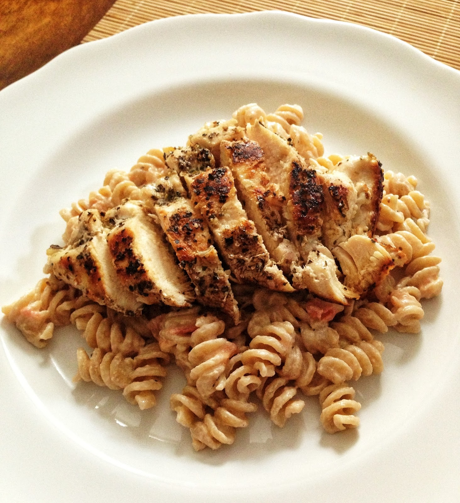 ... whole wheat fusilli with tomato & goat cheese sauce & spiced chicken