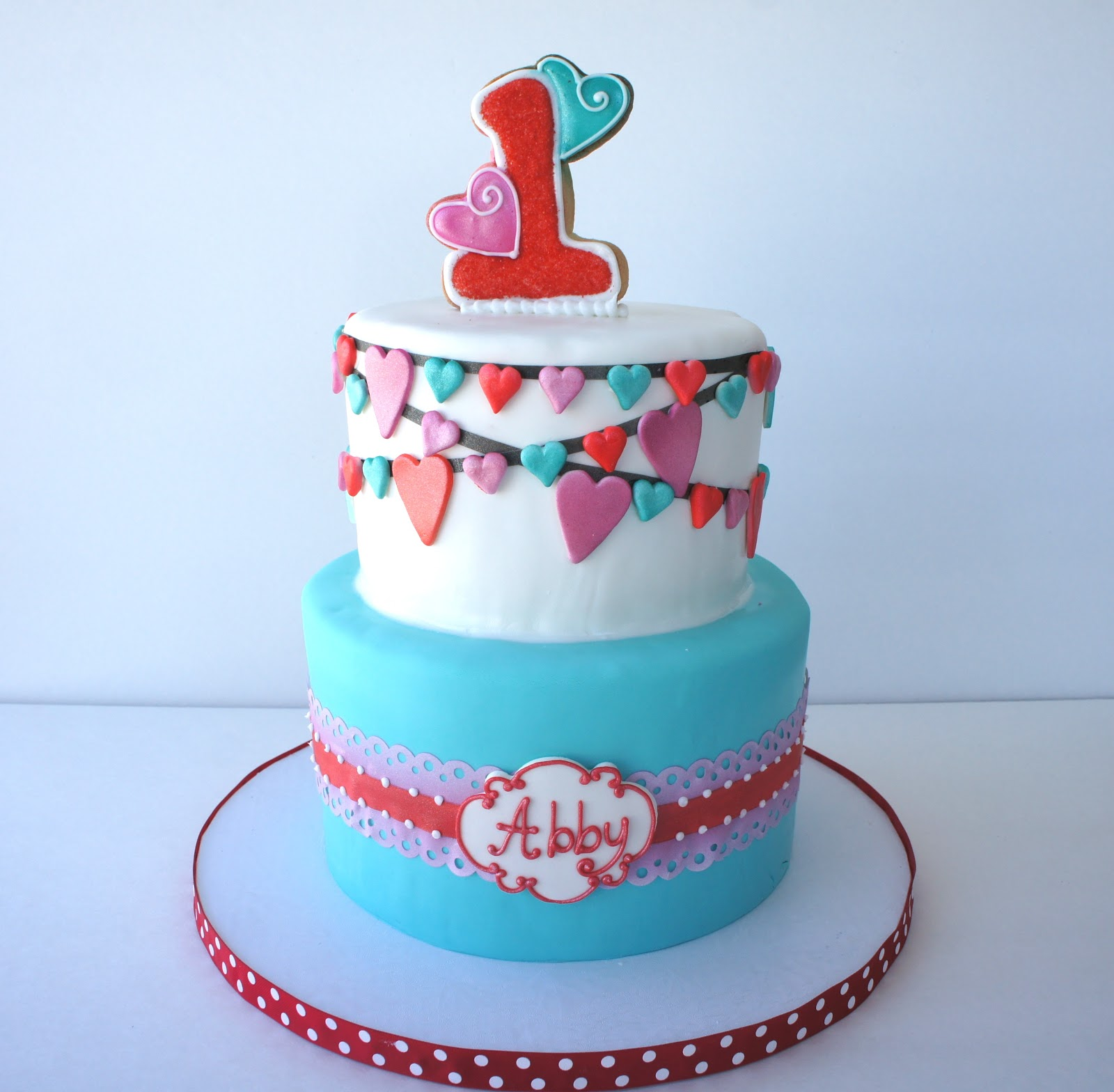 Heart themed first birthday cake Montreal Confections