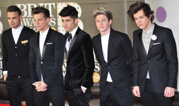 one direction group photo wearing black tux